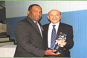 founder-chairman-peter-morales-receiving-an-award-website